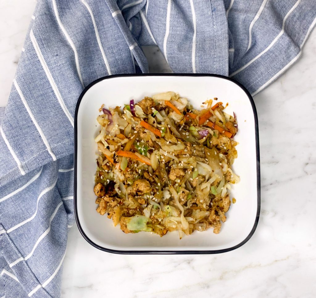 Image of simple egg roll in a bowl with cole slaw mix and ground turkey