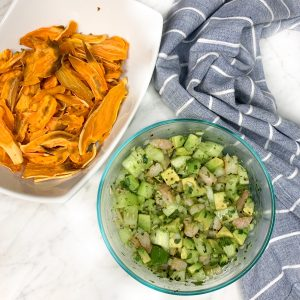 Bowl of shrimp avocado salad with a side of roasted sweet potato chips